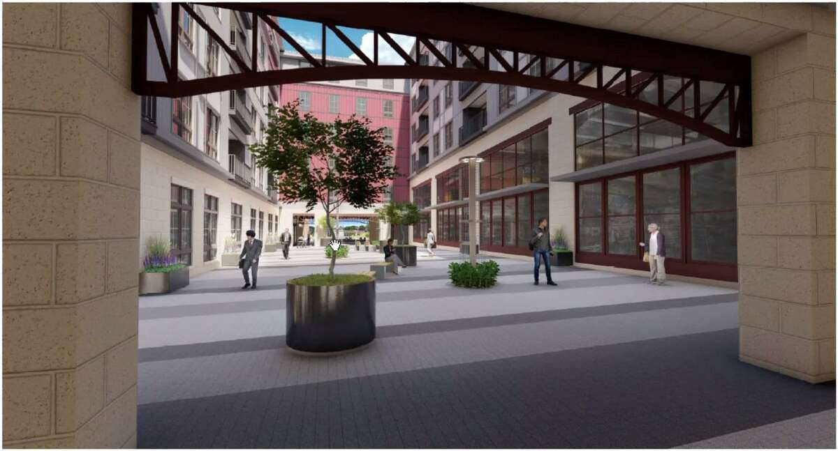 A rendering of the pedestrian walkway proposed for the center of The Pinnacle development. City officials and the developer at odds over whether retail and commercial space should be included along the walkway.
