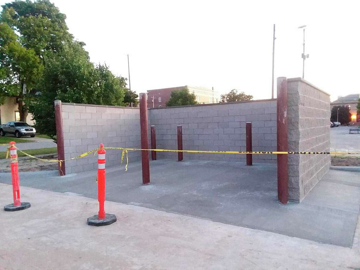 This dumpster corral was construction was nearing completion in the city on Water Street on July 30. Manistee City Council approved two dumpster corrals in April to be built to help with trash collection and aesthetics of refuse collection downtown. (File photo)
