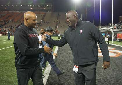 Stanford head football coach David Shaw celebrates with AD Bernard Muir after a win in Corvallis, Oregon, in 2017.