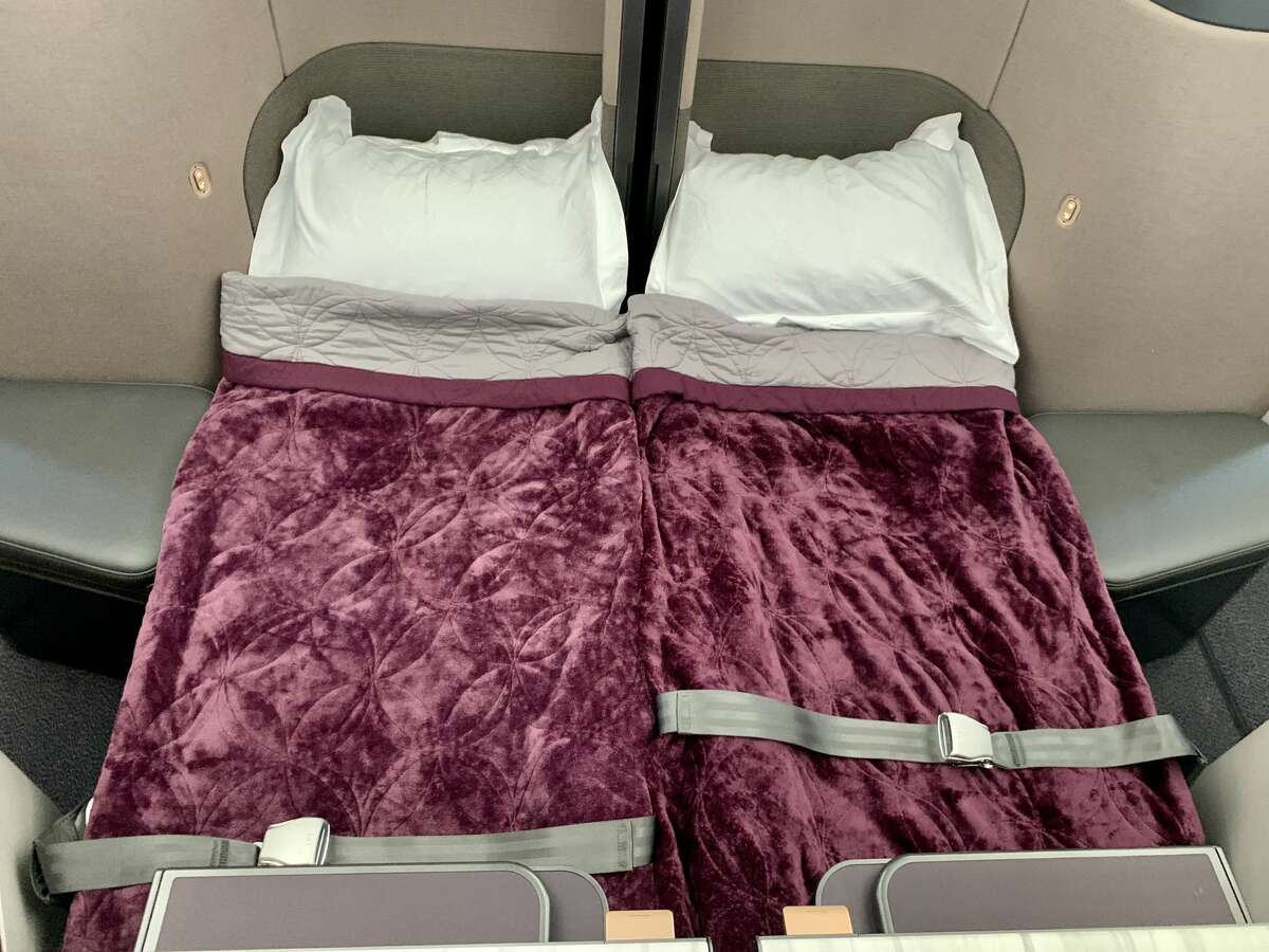 At bedtime, center business class Qsuite seats can be joined to create a fully flat double bed on the Qatar Airways Airbus A350 that will fly between San Francisco and Doha.
