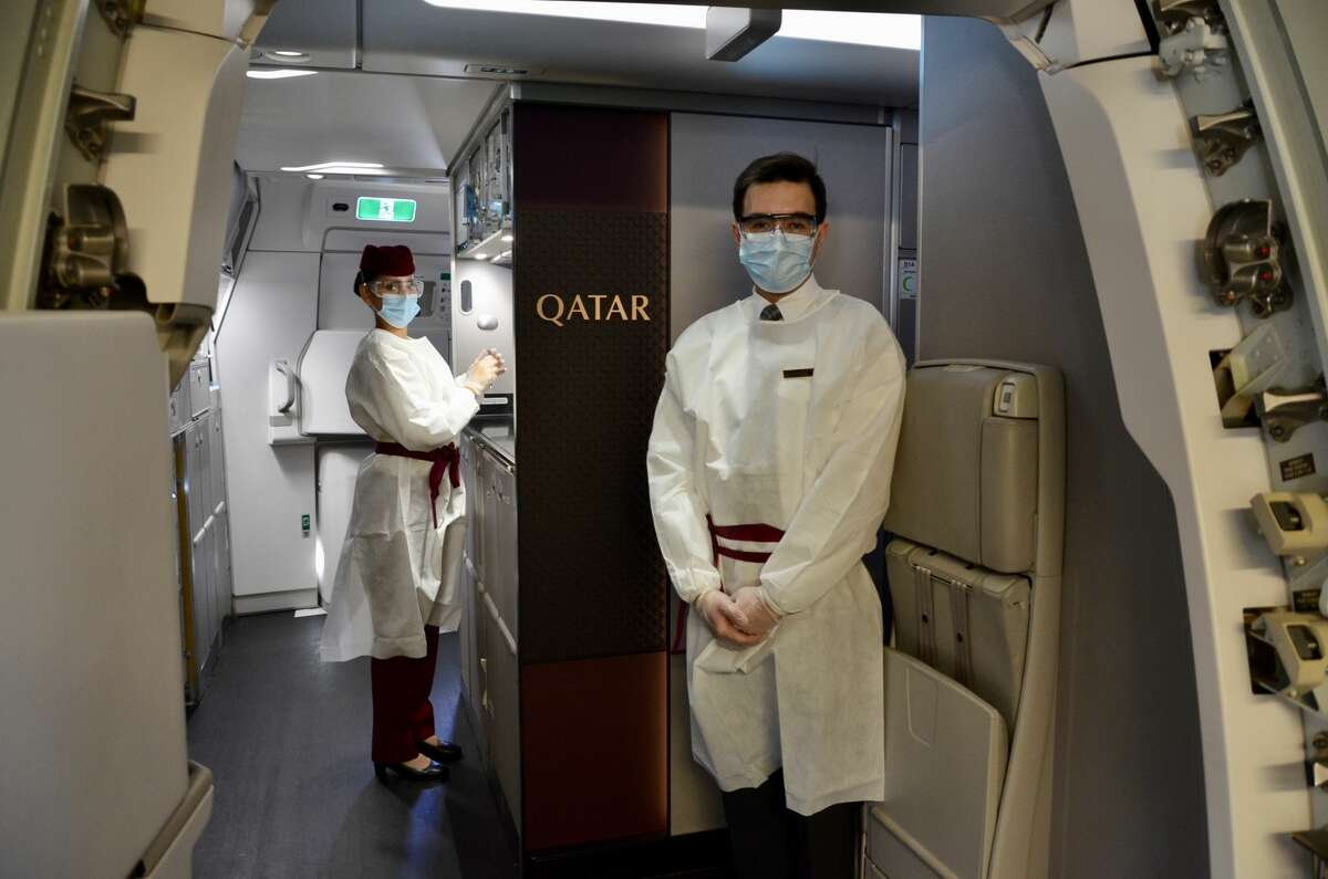 A very antiseptic but friendly welcome on board by cabin crew wearing special gowns, masks, gloves and goggles. SEE THE SLIDESHOW at the top of this post for an in-depth look!