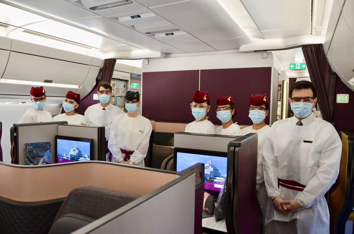 Mandatory masks hide the bright smiles from these Qatar Airways cabin crew members, but it's all part of the commitment the airline said it has to health and safety while on board. SEE THE SLIDESHOW at the top of this post for an in-depth look!