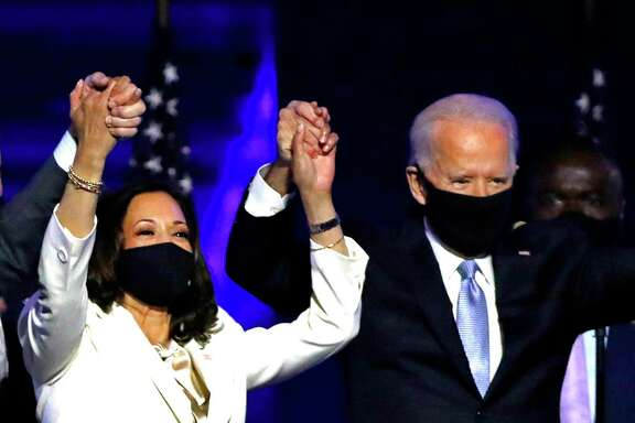 President-elect Joe Biden and Vice President-elect Kamala D. Harris wave to supporters Nov. 7 in Wilmington, Delaware, after Biden claims the election victory.
