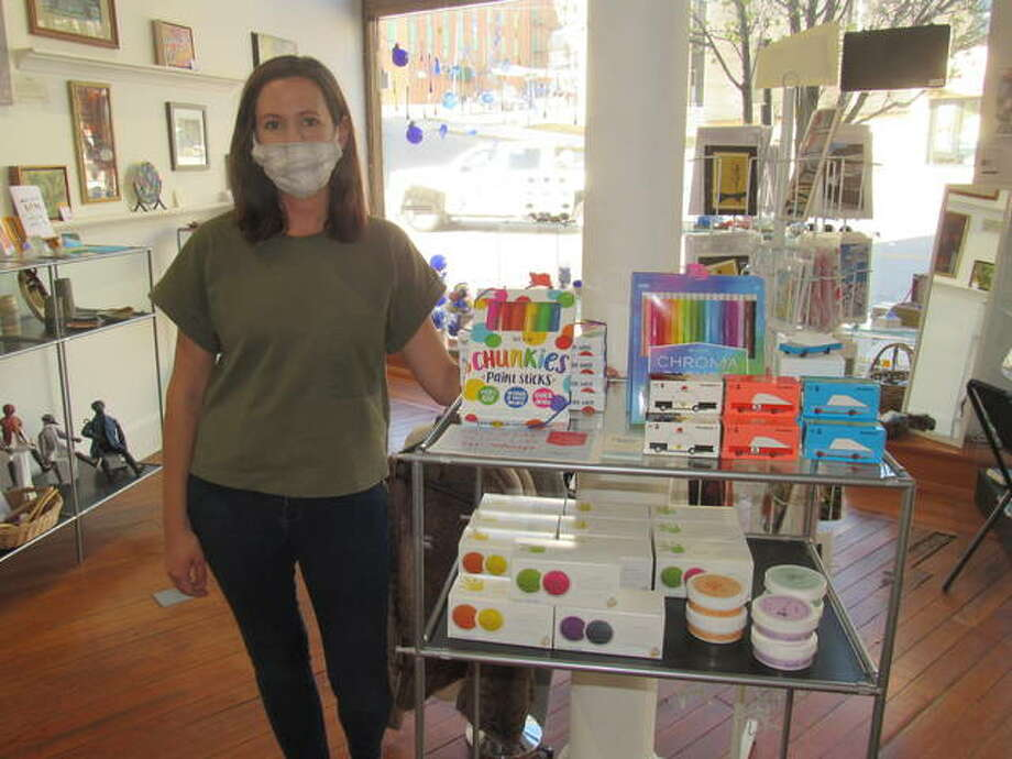 Marsha Pfister stands next to a collection of toys offered this weekend at Child's Play, a pop-up store planned in the Jacoby Arts Center in Alton.