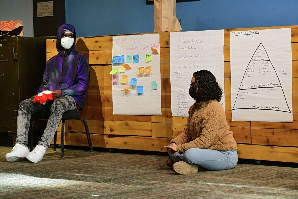 Mediation Matters volunteer Meralys Collazo, right, leads a restorative practice circle during the Bridge the Gap program as it's held in the Robb Alley of Proctors on Friday, Nov. 20, 2020 in Schenectady, N.Y. (Lori Van Buren/Times Union)