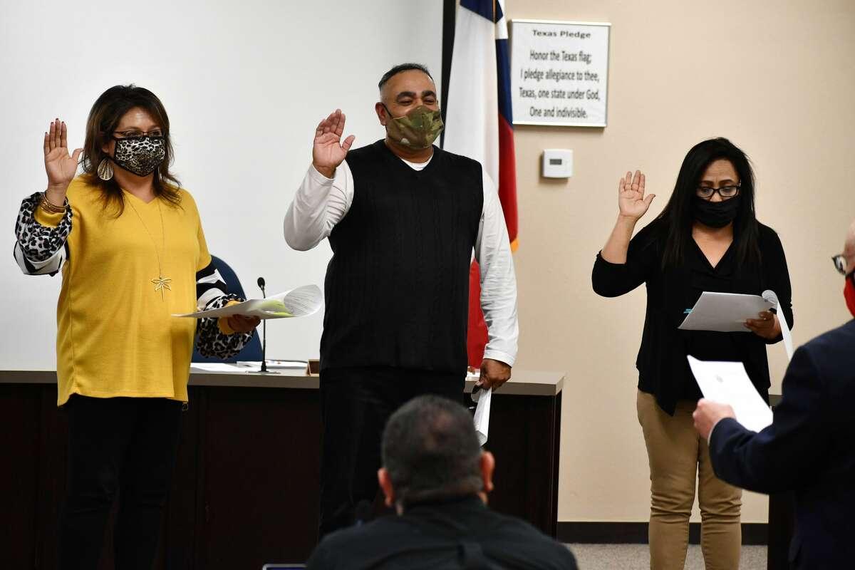 """(L-R) Sylvia De La Garza, Adam Soto and Veronica Salazar are sworn in by Judge Lowell """"Kregg"""" Hukill, 242nd District Court."""