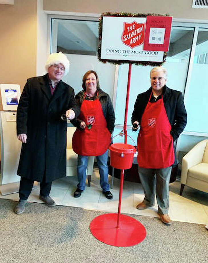 John Simmons, left, of Alton, who, along with his wife, Jayne, not pictured, co-chairs the Alton Salvation Army Red Kettle Campaign, rings a bell with former state Rep. Monica Bristow, D-Alton, and Alton Mayor Brant Walker in 2019