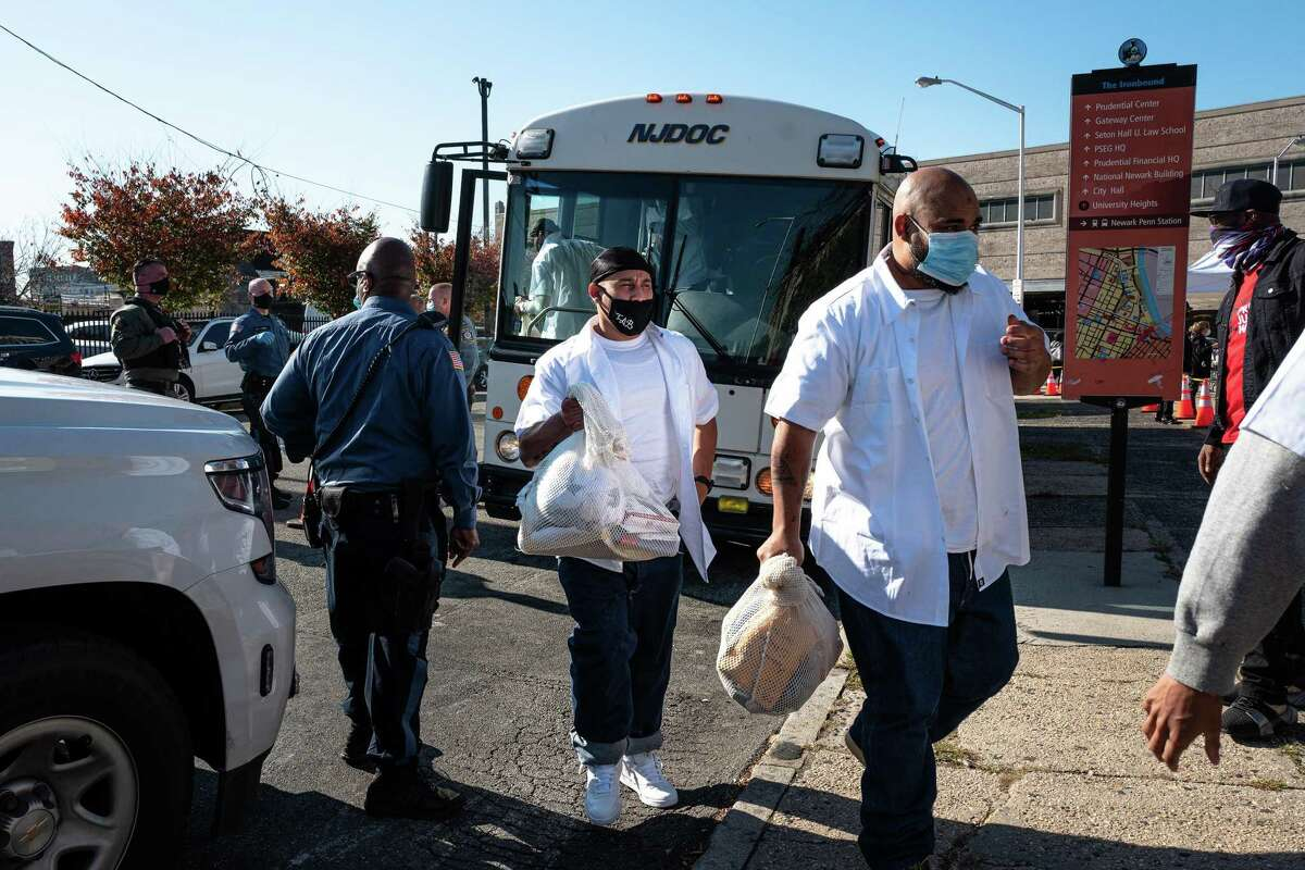Inmates from Northern State Prison are released early, in Newark, N.J., Nov. 4, 2020. More than 2,000 inmates were freed to reduce the spread of COVID-19 in the state's prison system. (Jonah Markowitz/The New York Times)