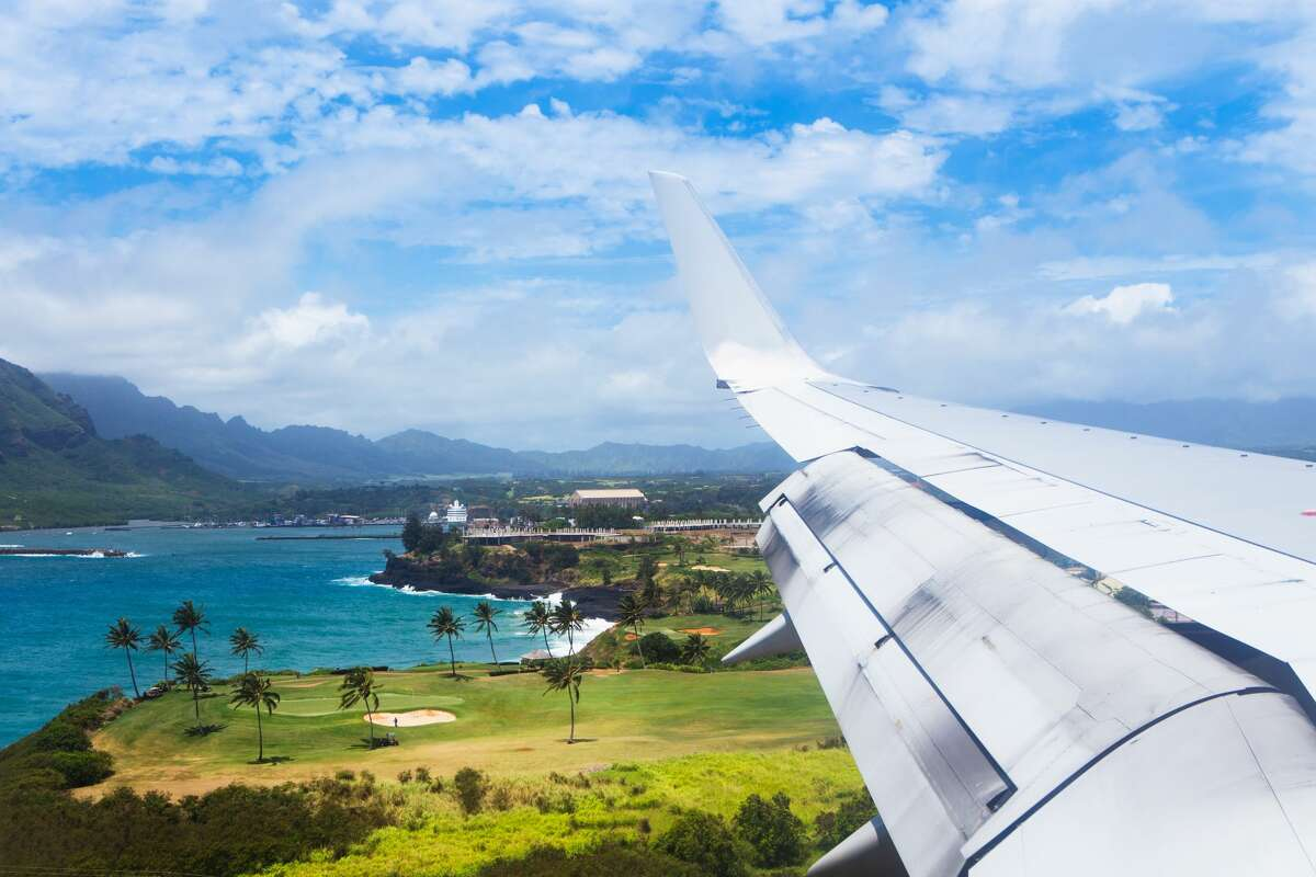 A plane flies into Lihue Airport on Kauai.