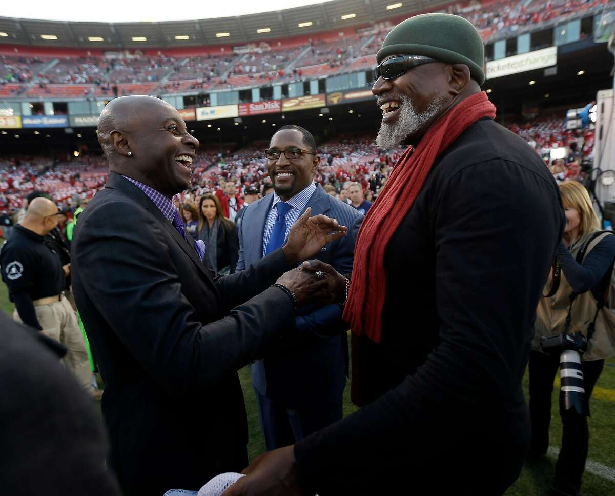 Former 49ers receiver Jerry Rice, left, and former Ravens linebacker Ray Lewis, center, talk with Dr. Harry Edwards at Candlestick Park before a 2013 game.