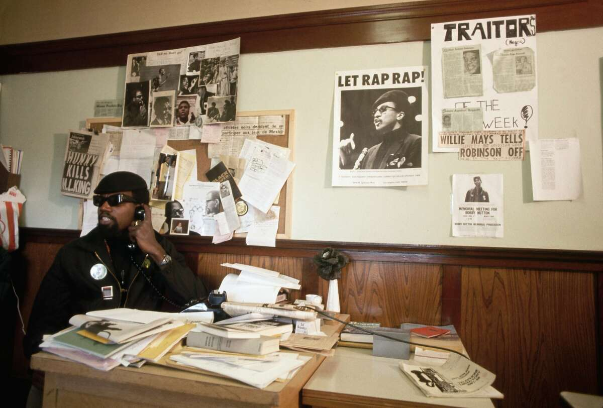 Harry Edwards, a lecturer at San Jose State who called for a boycott of the Olympic Games in Mexico City, talks on the telephone in his office.