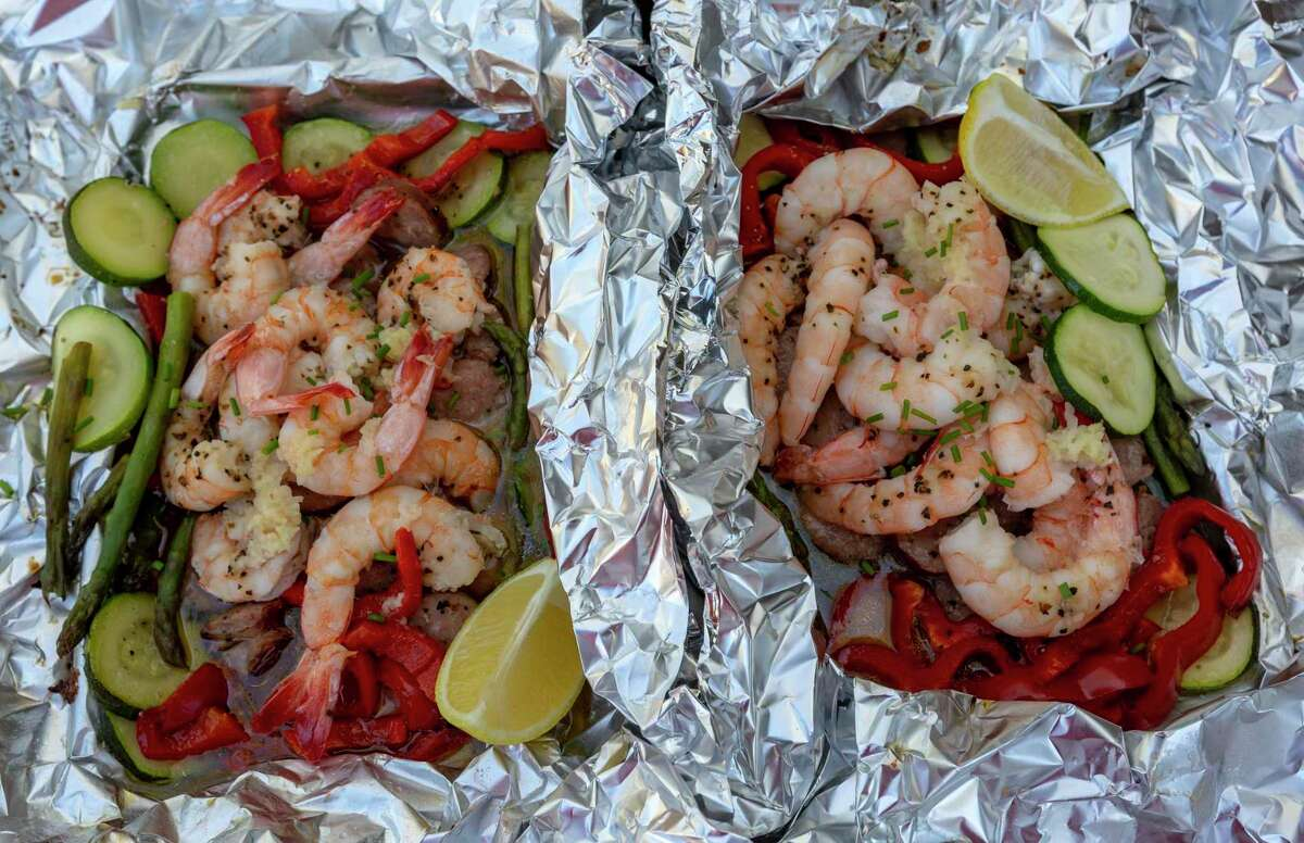 Cajun shrimp and sausage foil packs are loaded with vegetables and cooked for 15 minutes.