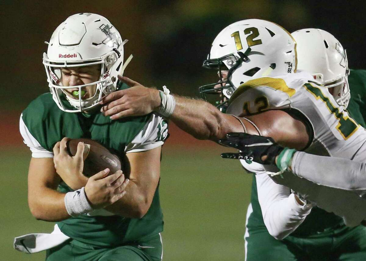 Kingwood Park Panthers quarterback Hudson Dezell (12) rushes against the Santa Fe Indians linebacker Brenton Beohm(12) in the fourth quarter in a high school football game on November 19, 2020 at Turner Stadium in Humble, TX.