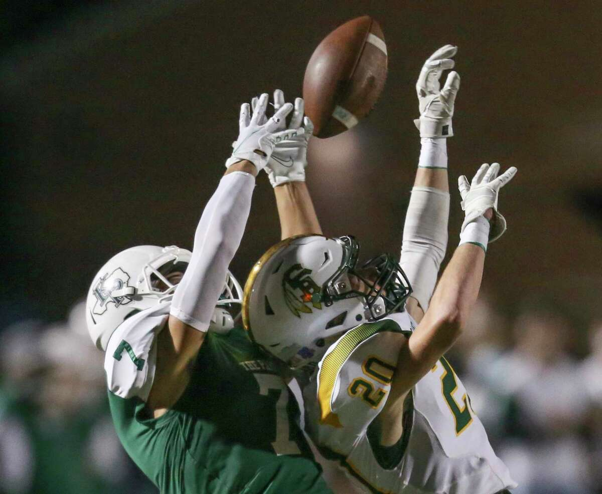 Santa Fe Indians cornerback Matthew Wilborn (20) breaks up a pass intended for Kingwood Park Panthers wide receiver Hayden Bender (7) in the first quarter in a high school football game on November 19, 2020 at Turner Stadium in Humble, TX.