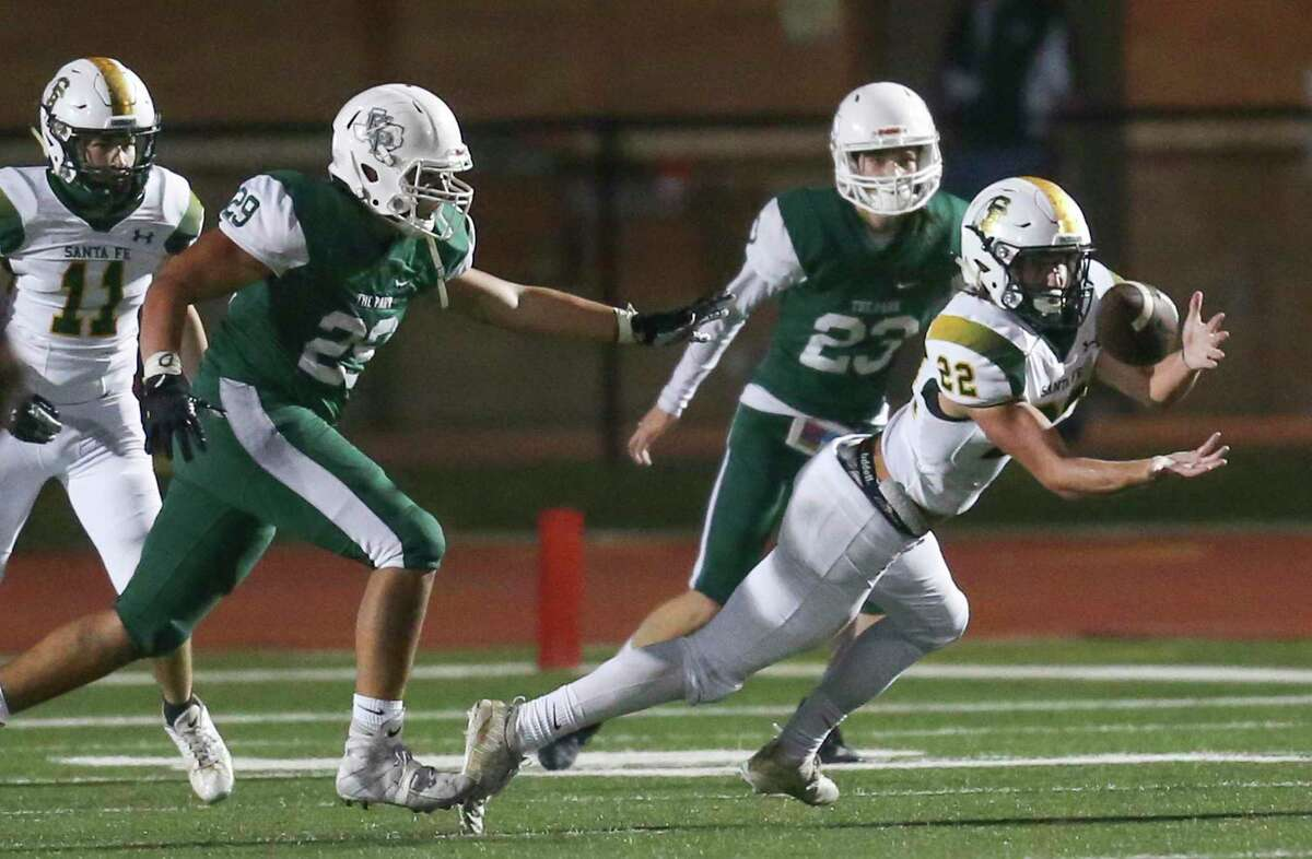 Santa Fe Indians wide receiver Kyle Fraser (22) makes a reception against Kingwood Park Panthers linebacker Pablo Cantu (29)in the fourth quarter in a high school football game on November 19, 2020 at Turner Stadium in Humble, TX.
