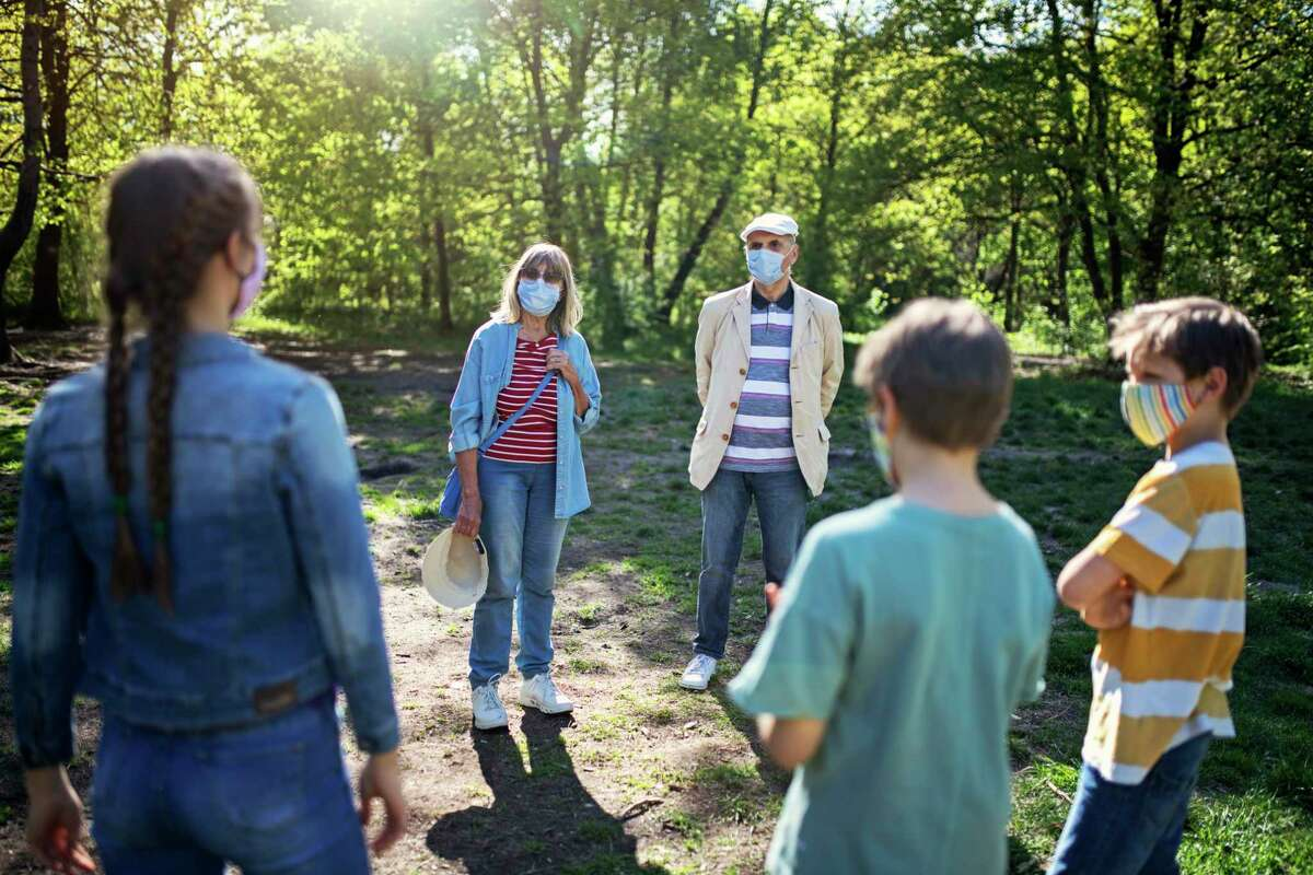 During the pandemic, experts urge people to wear masks, keep their distance, and meet outdoors.