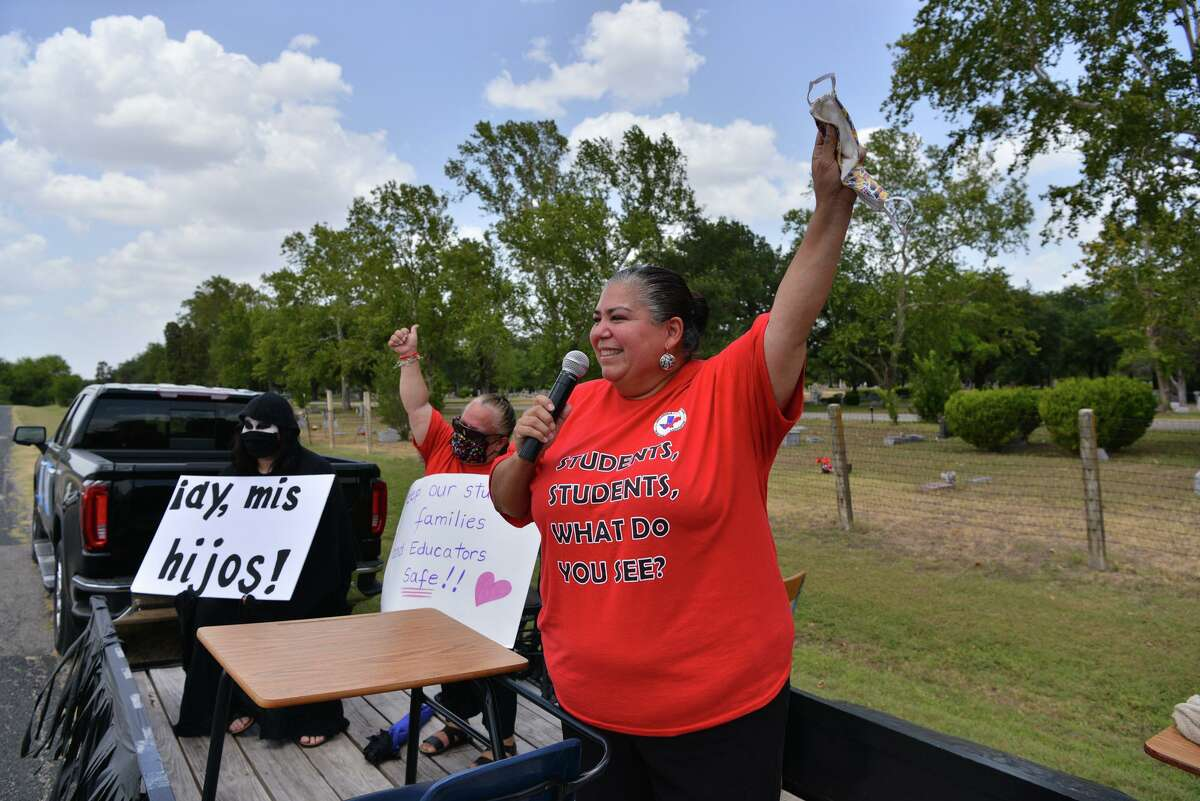 Julie Gimbel, president of the Harlandale teachers union, speaks prior to a car parade Sunday July 19, 2020 to send a message to the state and city school districts that there should not be a deadline to return to schools in person because of the uncertainty of COVID spread. They also say the annual assessment test, STAAR, should be waived another year.