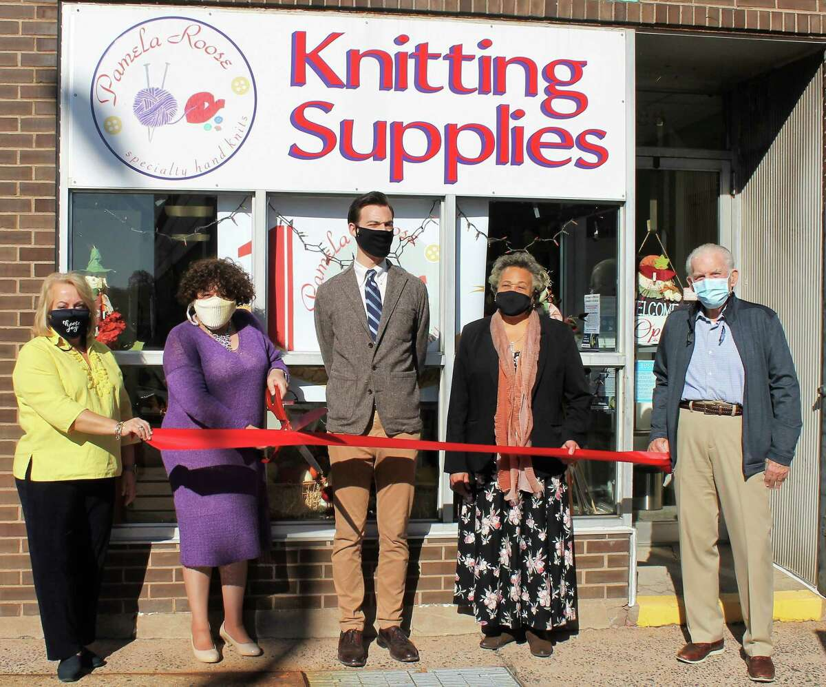Pamela Roose Knitting Supplies of Middletown celebrated its 10th anniversary Nov. 10. Those in attendance included, from left, Downtown Business District Chairwoman Marie Kalita, owner and Middlesex County Chamber of Commerce Central Business Bureau Chairwoman Pamela Steele, Mayor Ben Florsheim, the owner's sister Faith Jackson, and Chamber President Larry McHugh.