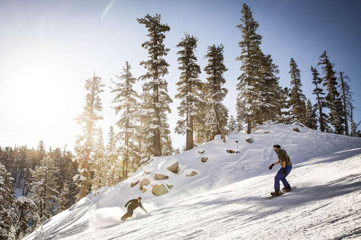 Snowboarders enjoy opening day at Heavenly Mountain Resort in South Lake Tahoe, California, November 20, 2020.