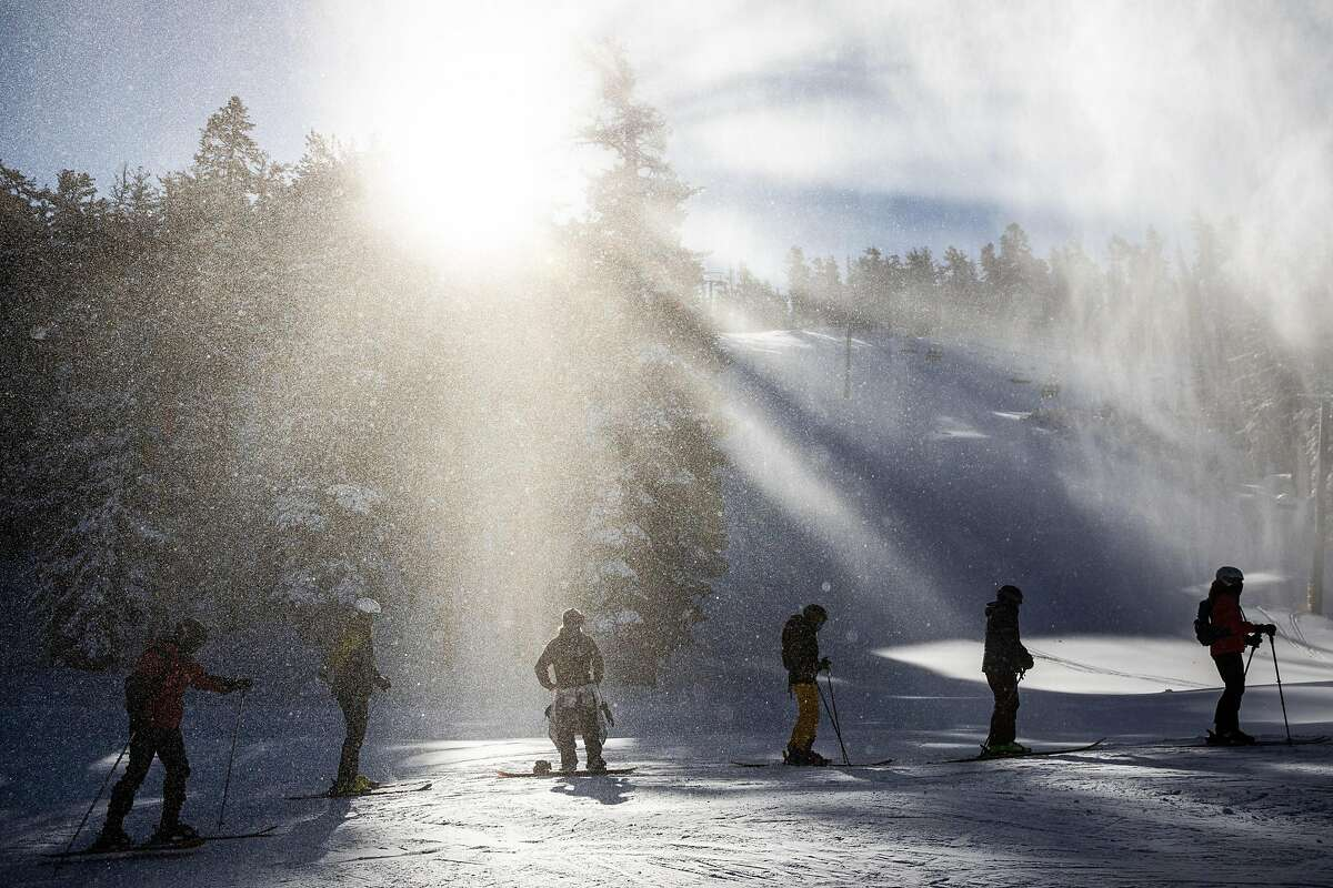 Skiers and snowboarders wait in line for the lift during opening day at Heavenly Mountain Resort in South Lake Tahoe, California, November 20, 2020.