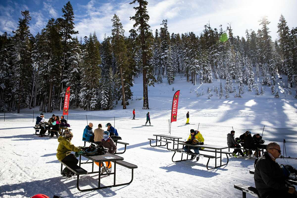 Picnic tables are spread out for outside dining at Heavenly Mountain Resort in South Lake Tahoe, California, November 20, 2020.
