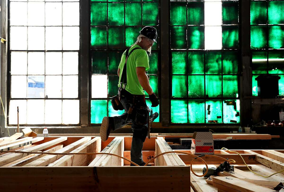 Carpenter John Dryden builds corridor walls at the Factory_OS plant in Vallejo last year.