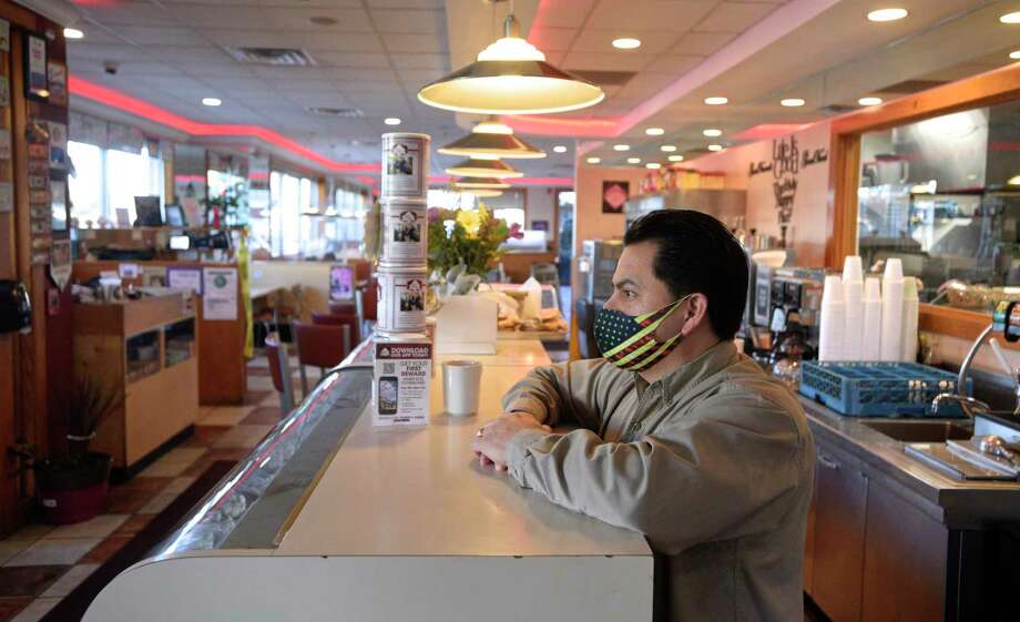 Elmer Palma, owner pf Elmer's Diner, has a cup of coffee and looks over the restaurant. Restaurants are adapting to COVID-19 restrictions and colder weather. Wednesday, November 18, 2020, in Danbury, Conn. Photo: H John Voorhees III / Hearst Connecticut Media / The News-Times