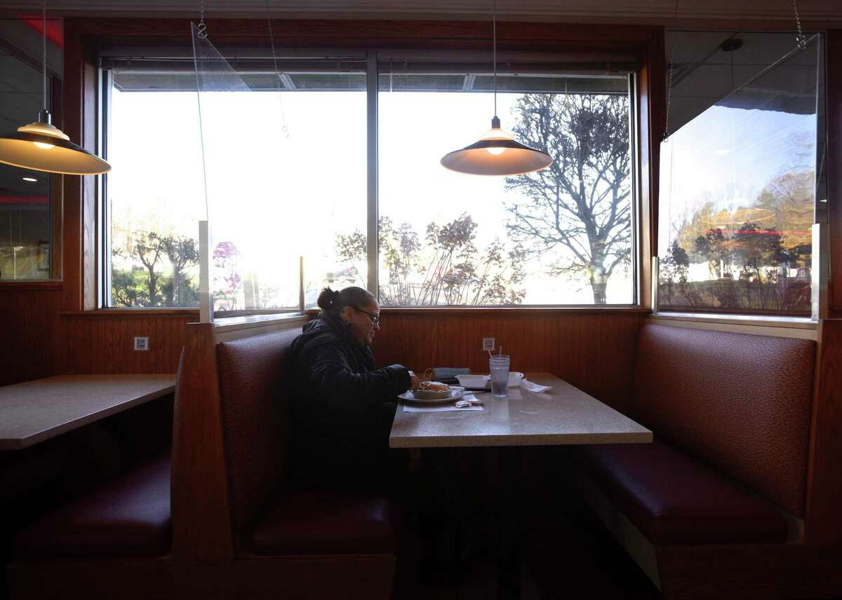 Raquel Sosa, of Danbury, eats lunch at Elmer's Diner. Restaurants are adapting to COVID-19 restrictions and colder weather. Wednesday, November 18, 2020, in Danbury, Conn.