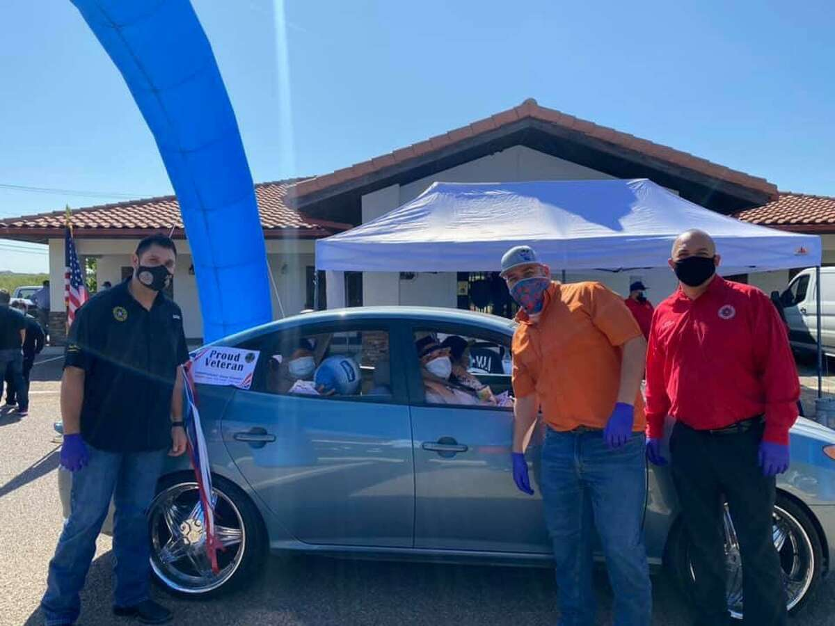 Webb County Precinct 1 Commissioner Jesse Gonzalez with assistance from Councilman Vidal Rodriguez and Precinct 2 Place 1 Justice of the Peace Bobby Quintana provided thanksgiving meals to veterans during the Fifth Annual Giving Thanks To Those Who Served Drive-Thru Giveaway.