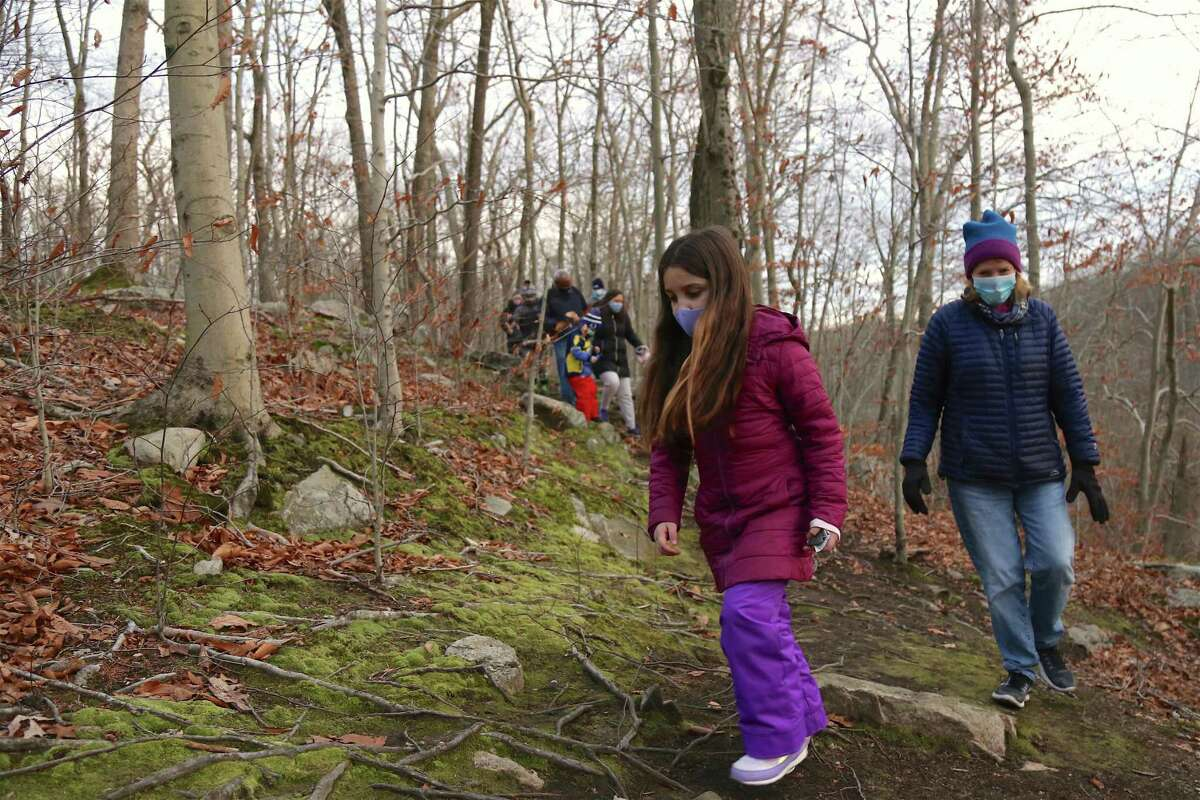 Cara Boland, 7, and Liz Marcal, both of Wilton, work their way along the trail at Woodcock Nature Center at the sunset hike on Thursday, Nov. 19, 2020.