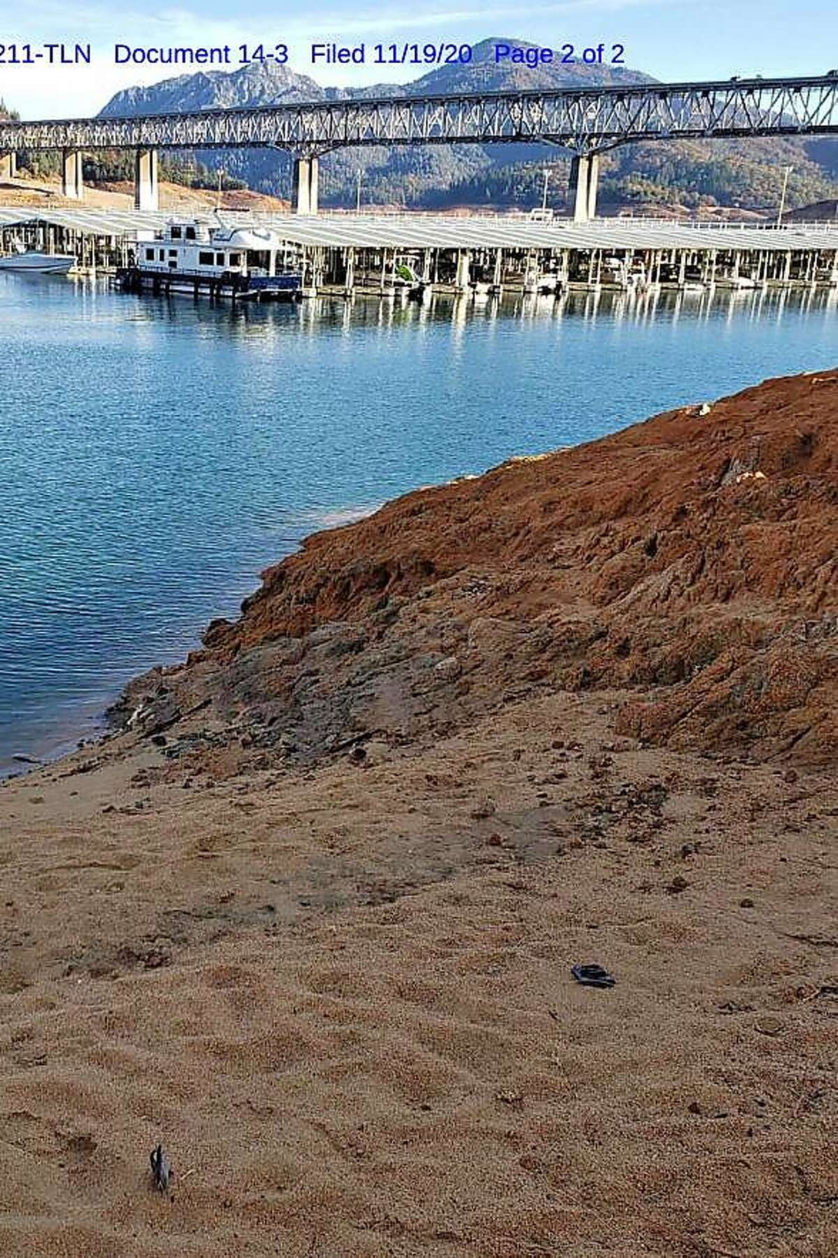 Prosecutors believe Matthew Piercey, who is charged with running a $36 million Ponzi scheme, entered Lake Shasta on this shoreline after they found one of his flip-flops (lower right) nearby and tried to flee federal agents using a submersible device.