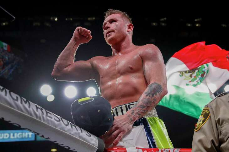 Canelo Alvarez celebrates after defeating Sergey Kovalev by knockout in a light heavyweight WBO title bout, in Las Vegas. Alvarez will return to the ring in a world super-middleweight title fight against Britain's Callum Smith on Dec. 19, the boxers announced early Wednesday, Nov. 18, 2020.