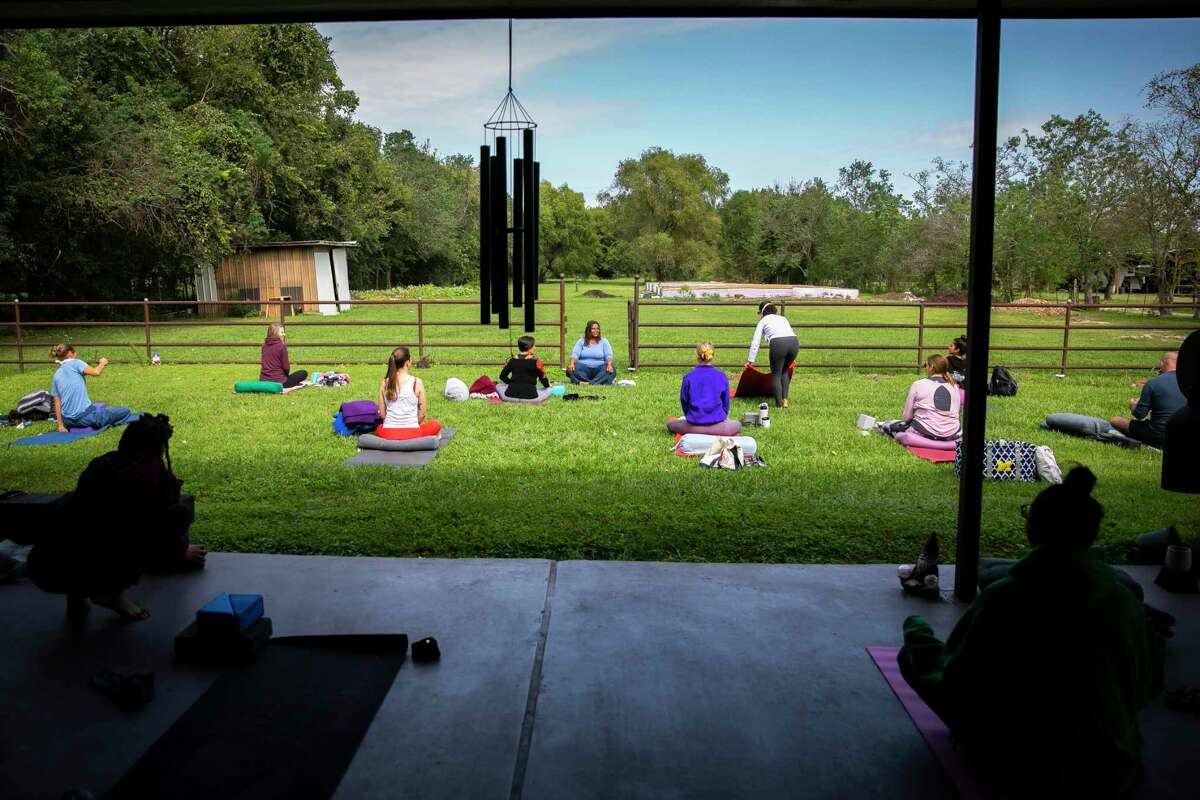 Tamika Caston-Miller leads a yoga class for future instructors at The Ranch Houston, a multi-faceted yoga facility and garden education center on Saturday, Oct. 24, 2020.