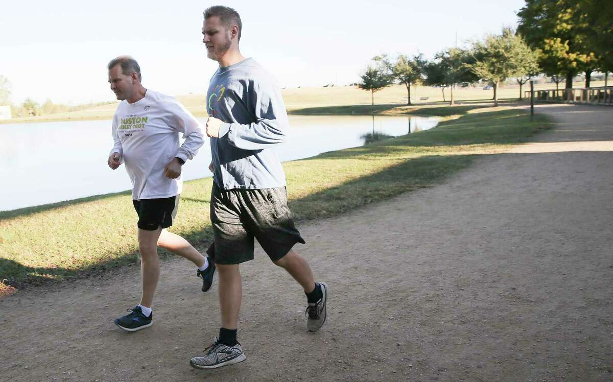 Todd Breton, left, runs for a photo with his son, Michael in Sugar Land on Wednesday, Nov. 18, 2020. Todd Breton has run every Houston Turkey Trot since it started.