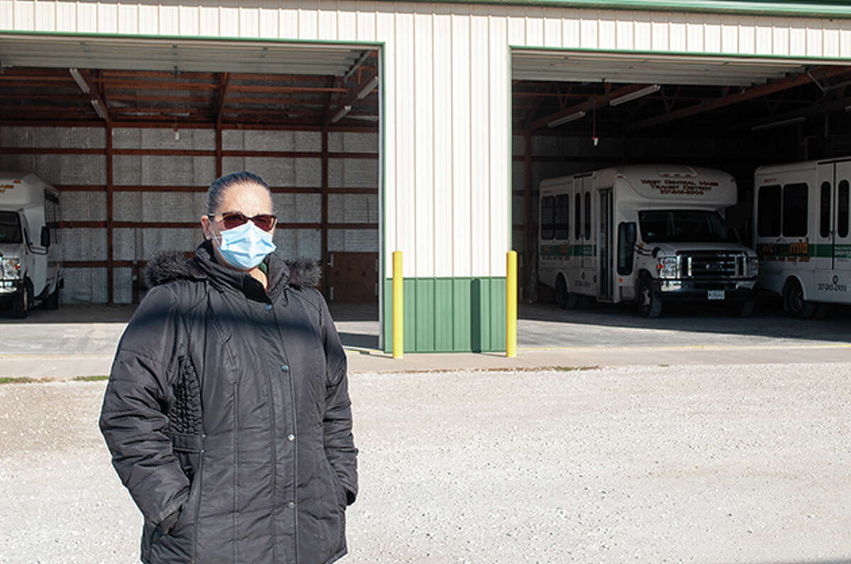 West Central Mass Transit District's executive director, R. Jean Jumper, stands on the Morgan County lot on Walnut Street. The transit district has received $2.5 million for capital improvements. Plans for the money include a new building; a centralized, computerized dispatch system; improvements to current buildings and paving of the parking lot. Work is slated to begin in spring.
