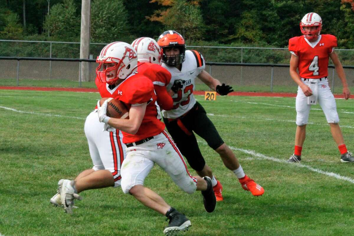 Benzie Central running back Sam Ross cuts upfield after picking a block to spring him for a big again against Cheboygan on Sept. 16. (File photo)