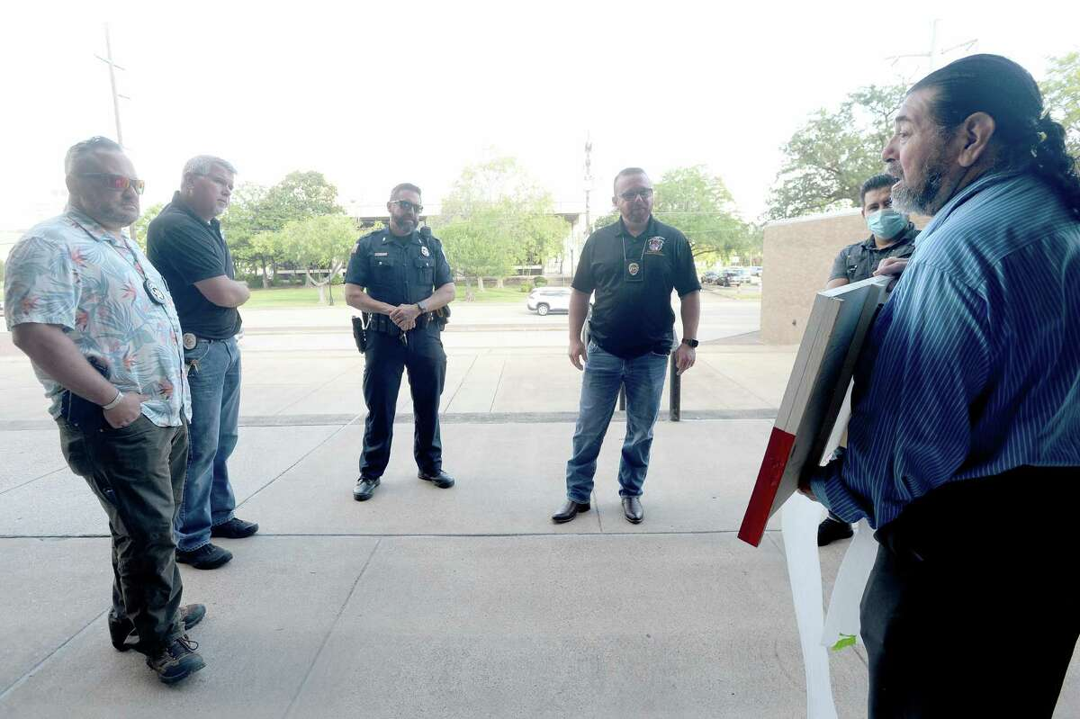Fernando Ramirez talks with members of the Beaumont Police union, including (from left) Aaron Lewallen, Kane Dean, Robby Campberll and Chuck Duchamp , as he and Joselo Hernandez present them with a Back the Blue plaque at Beaumont Police headquarters Friday morning. Photo taken Friday, September 4, 2020 Kim Brent/The Enterprise