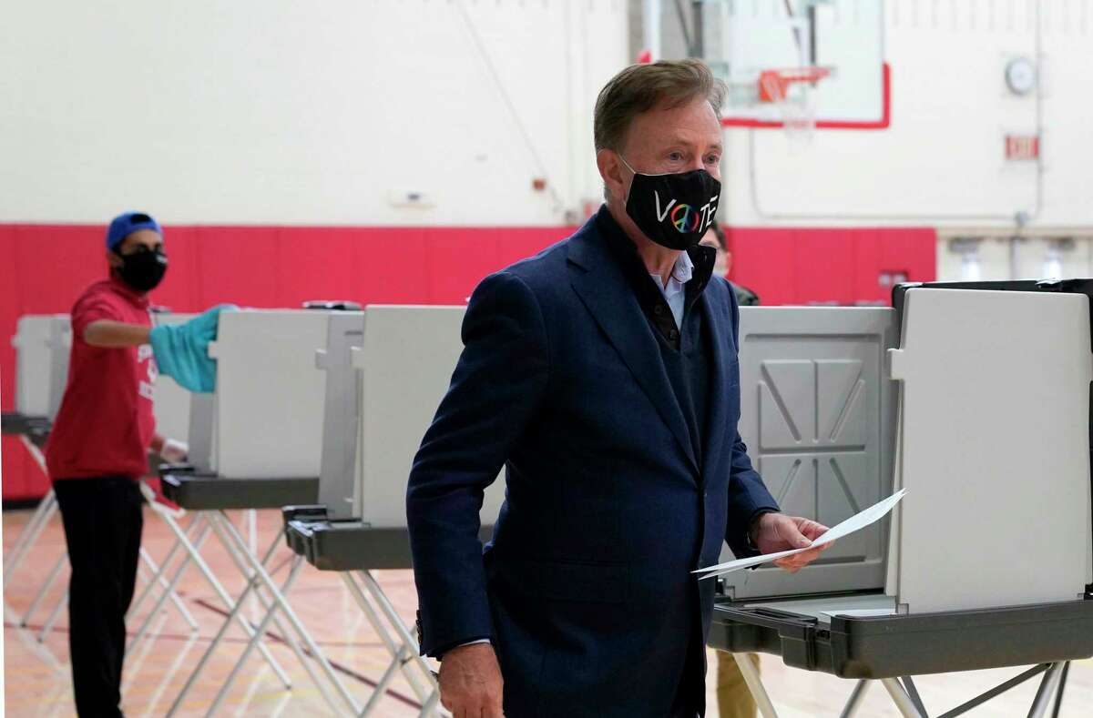 Gov. Ned Lamont, shown casting his vote at Greenwich High School on Nov. 3, said Thursday that contact tracing shows COVID-19 cases related to sports are affecting schools' ability to stay open for in-person education.