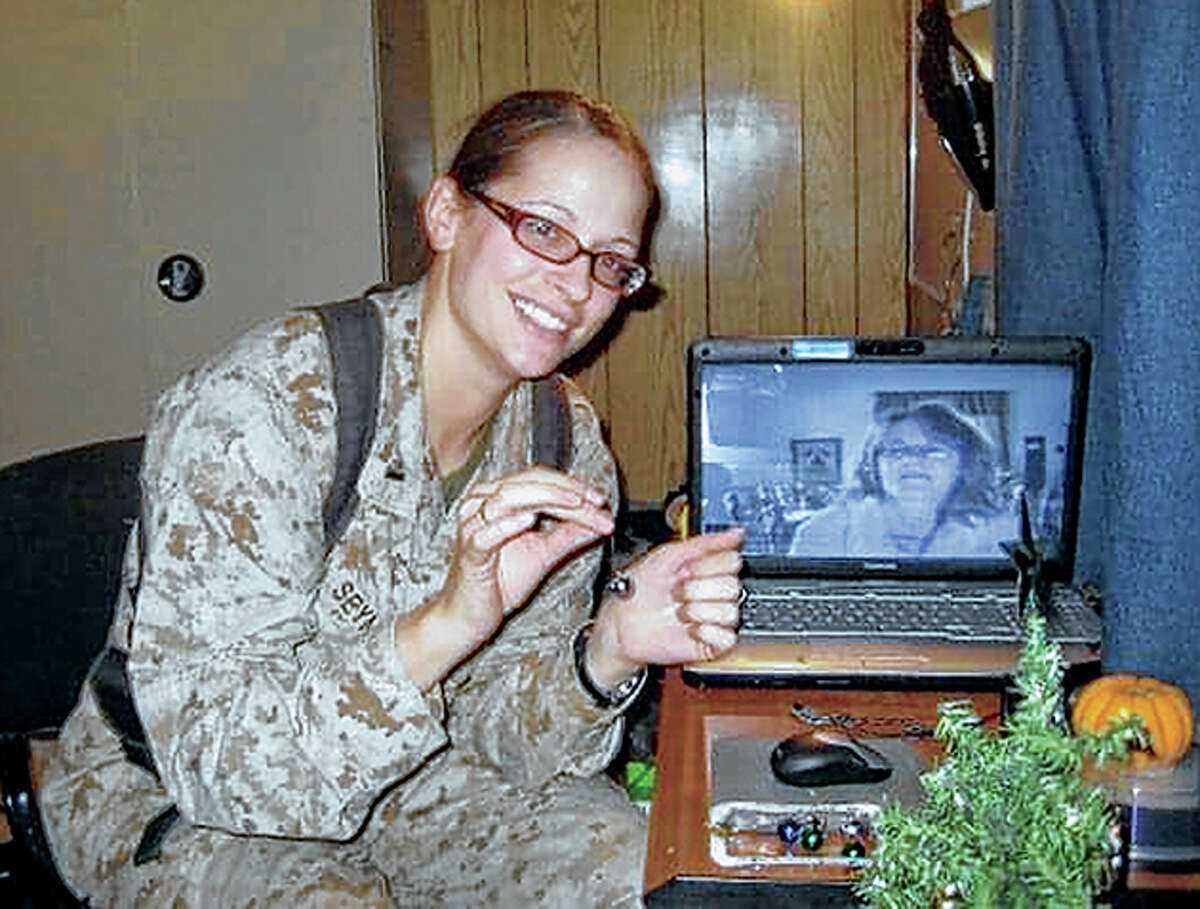 Writer Maggie Seymour shares a video-conference call with her aunt, Janet, during a Christmas when Seymour was deployed with the U.S. Marines.