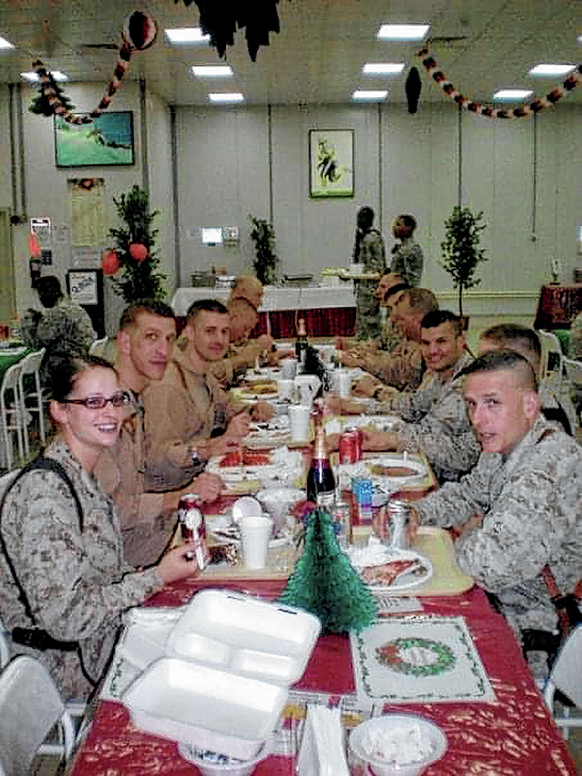 Maggie Seymour shares a meal with her fellow Marines during a Thanksgiving deployed to Iraq.