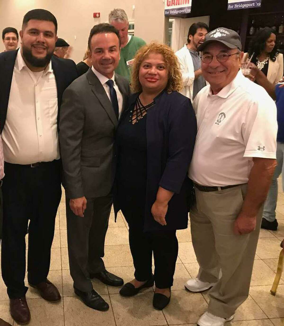 Dennis Scinto, right, who had COVID-19, recently died. He is shown here with state Rep. Chris Rosario, Mayor Joe Ganim, and Council President Aidee Nieves.