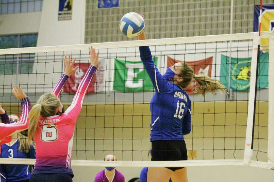 Sophie Wisnksi comes down with a big hit during a win over Manistee on Oct. 8. (File photo)