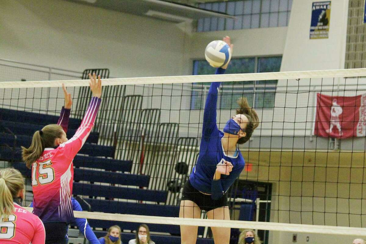 Kristin Bonecutter rises above the net for a kill against Manistee on Oct. 8. (File photo)