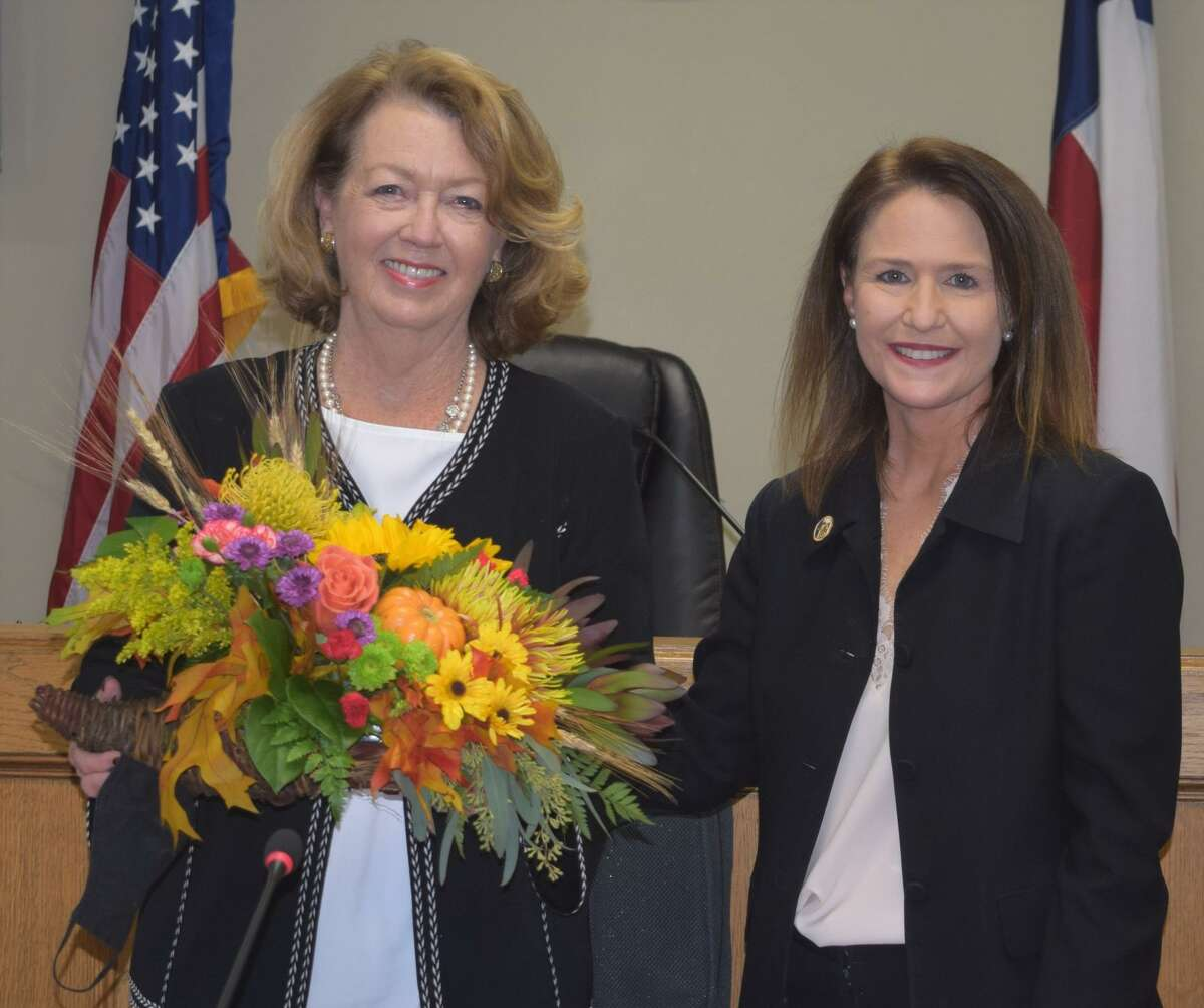 Outgoing Richmond Mayor Evalyn Moore is presented with a floral arrangement by City Manager Terri Vela on Nov. 16, 2020. She succeeded her husband Hilmar as mayor, and her departure ends 71 years in which someone with the last name of Moore has been mayor of Richmond, Texas.