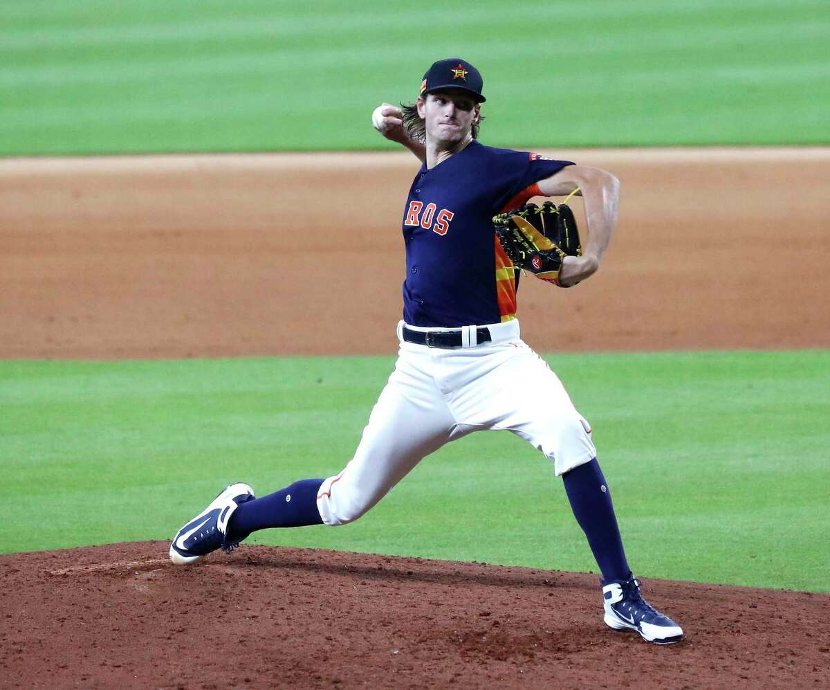 Houston Astros pitcher Forrest Whitley, pitching in an intrasquad game during the Astros summer camp in July, has had an aggressive regimen so far in the offseason. The Astros placed him on the 40-man roster on Friday.