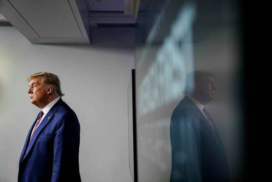 President Trump stands in the James S. Brady Press Briefing Room of the White House on Friday. Photo: Washington Post Photo By Jabin Botsford / The Washington Post