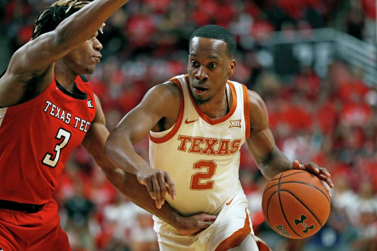 FILE - In this Feb. 29, 2020, file photo, Texas' Matt Coleman III (2) drives the ball around Texas Tech's Jahmi'us Ramsey (3) during the first half of an NCAA college basketball game in Lubbock, Texas. Coleman is the floor leader who has seen everything. Andrew Jones and Courtney Ramey bring playmaking and defense. Those three found a rhythm that propelled a five-game win streak late last season. (AP Photo/Brad Tollefson, File)