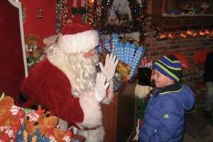 Carl Bozenski's Christmas Village in Torrington is visited annually by more than 30,000 people. This year, with COVID-19 restrictions in place, the village opens Dec. 13.