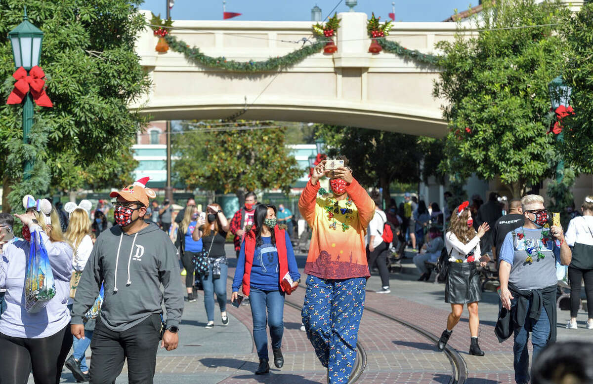 Visitors walk down Buena Vista Street inside Disney California Adventure Park in Anaheim, Calif., on Thursday, Nov. 19, 2020.