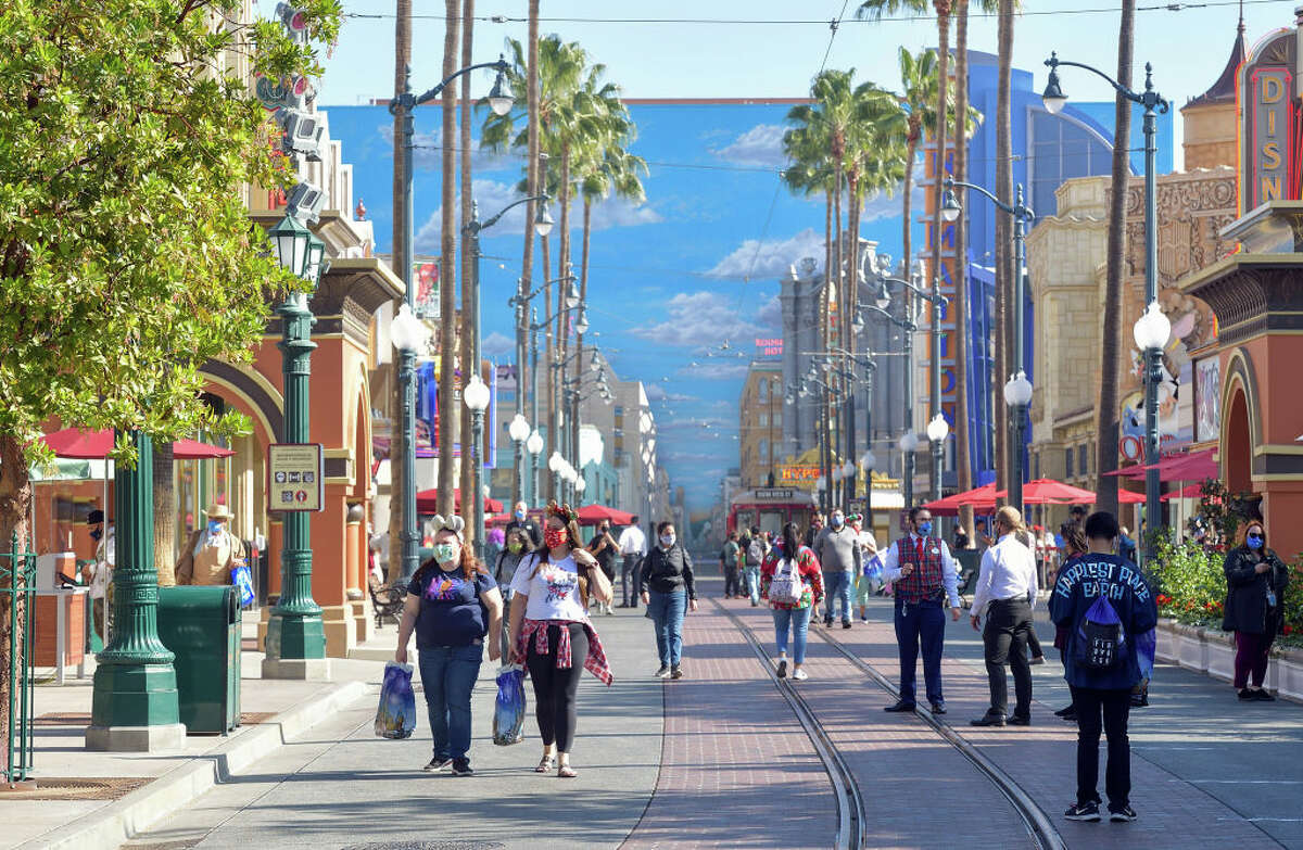Visitors walk down Hollywood Blvd inside Disney California Adventure Park in Anaheim, CA, on Thursday, November 19, 2020.